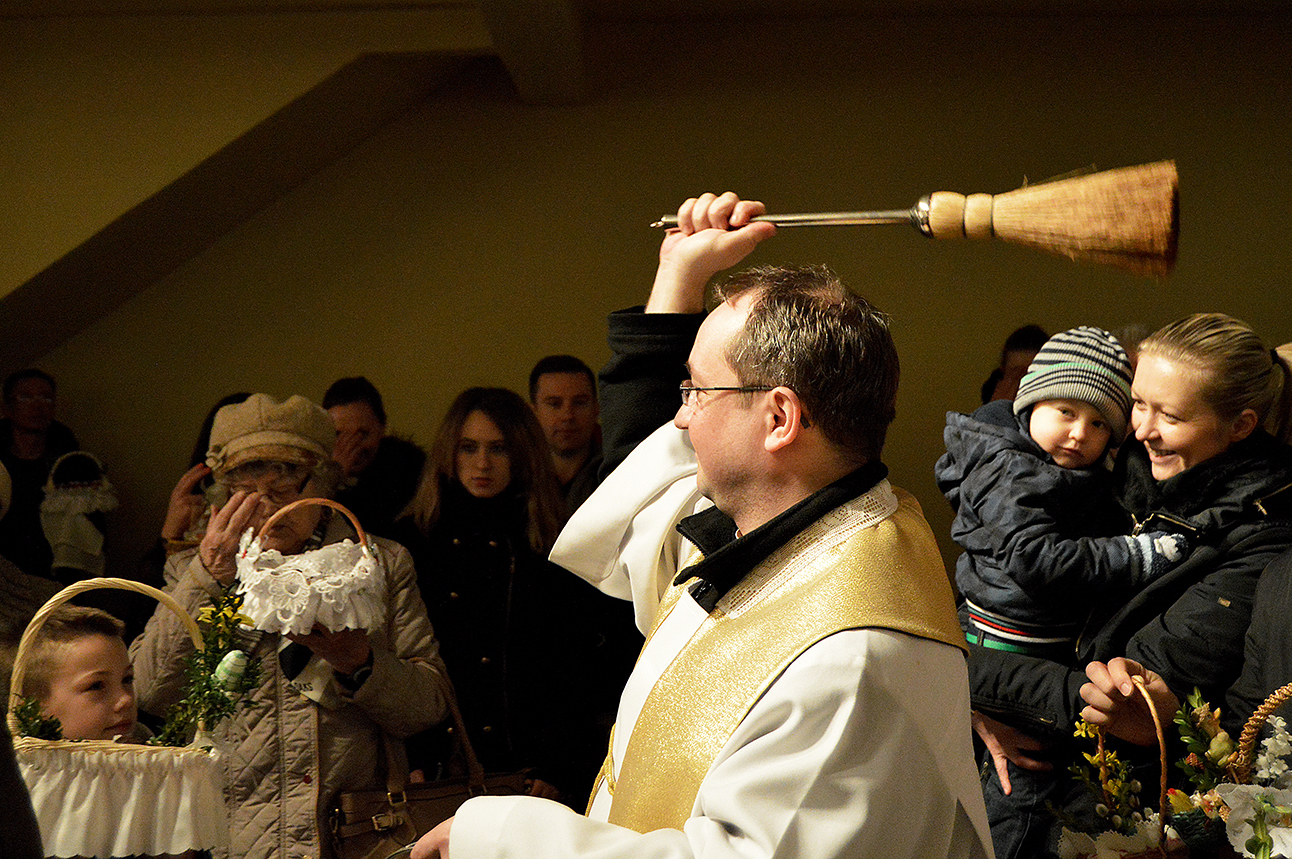 The day before Easter, the church packs with Polish families. They hold up their baskets with eggs, flowers and other food to receive the priest's blessing.